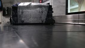 Luggage claim belt. Luggage claim conveyor belt of an airport stock video footage