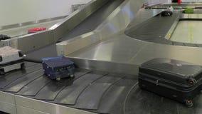 Luggage claim belt. Luggage claim conveyor belt of an airport stock video