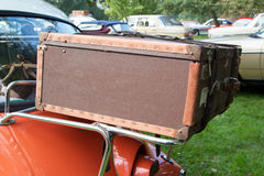 Luggage on classic car. Olden times for traveling Stock Image