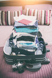 Luggage with clothes and other items Stock Photos