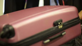 Luggage Coming on Conveyor Belt. In airport terminal stock footage