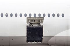 Luggage compartment and cargo section in the airplane open on inspection. Stock Photo