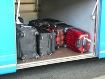 Luggage Compartment. Several suitcases in the luggage compartment of a bus stock images