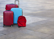 Luggage consisting of three large suitcases and travel backpack Stock Photo