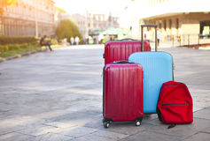 Luggage consisting of three large suitcases and travel backpack Stock Photos
