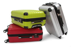 Luggage. Consisting of three polycarbonate suitcases isolated on white royalty free stock image