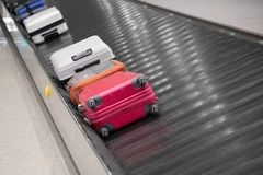 Luggage on a conveyor belt. At the airport Royalty Free Stock Image