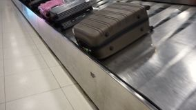 Luggage from conveyor belt at airport.  stock video
