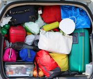 Luggage in the family car before the long holiday trip. Lot of luggage in the family car before the long holiday trip Stock Photo