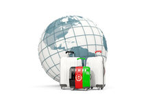 Luggage with flag of afghanistan. Three bags in front of globe. 3D illustration Royalty Free Stock Photos