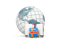 Luggage with flag of aland islands. Three bags in front of globe. 3D illustration Royalty Free Stock Photo