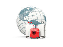Luggage with flag of albania. Three bags in front of globe. 3D illustration Royalty Free Stock Images