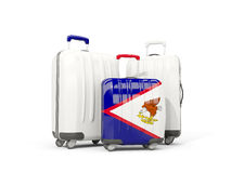 Luggage with flag of american samoa. Three bags isolated on whit. E. 3D illustration Stock Photos