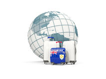 Luggage with flag of anguilla. Three bags in front of globe. 3D illustration Stock Images