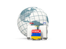Luggage with flag of armenia. Three bags in front of globe. 3D illustration Royalty Free Stock Image
