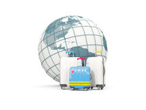 Luggage with flag of aruba. Three bags in front of globe. 3D illustration Stock Image