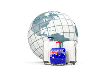 Luggage with flag of australia. Three bags in front of globe. 3D illustration Stock Photo