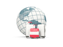Luggage with flag of austria. Three bags in front of globe. 3D illustration Stock Image