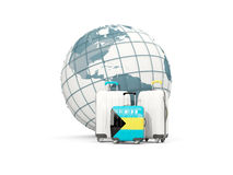 Luggage with flag of bahamas. Three bags in front of globe. 3D illustration Royalty Free Stock Photo