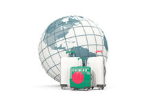 Luggage with flag of bangladesh. Three bags in front of globe. 3D illustration Royalty Free Stock Photos