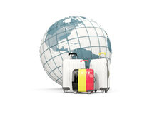 Luggage with flag of belgium. Three bags in front of globe. 3D illustration Royalty Free Stock Photography
