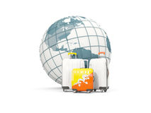 Luggage with flag of bhutan. Three bags in front of globe. 3D illustration Royalty Free Stock Photography
