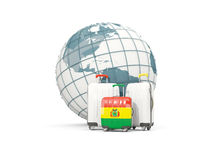 Luggage with flag of bolivia. Three bags in front of globe. 3D illustration Stock Photography