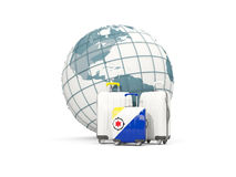 Luggage with flag of bonaire. Three bags in front of globe. 3D illustration Stock Photo