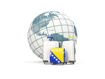 Luggage with flag of bosnia and herzegovina. Three bags in front. Of globe. 3D illustration Stock Image