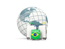 Luggage with flag of brazil. Three bags in front of globe. 3D illustration Stock Photos