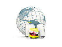 Luggage with flag of brunei. Three bags in front of globe. 3D illustration Stock Image