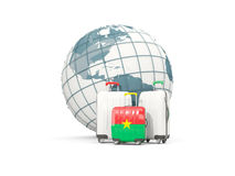 Luggage with flag of burkina faso. Three bags in front of globe. 3D illustration Royalty Free Stock Photo