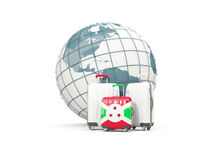 Luggage with flag of burundi. Three bags in front of globe. 3D illustration Royalty Free Stock Image