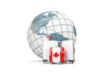 Luggage with flag of canada. Three bags in front of globe. 3D illustration Royalty Free Stock Photo