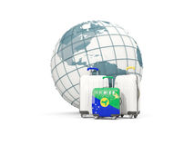 Luggage with flag of christmas island. Three bags in front of gl. Obe. 3D illustration Stock Photo