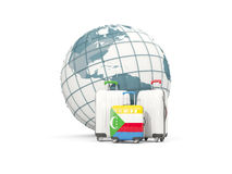Luggage with flag of comoros. Three bags in front of globe. 3D illustration Royalty Free Stock Photo