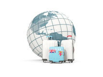 Luggage with flag of fiji. Three bags in front of globe Royalty Free Stock Photos
