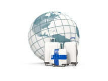 Luggage with flag of finland. Three bags in front of globe Stock Image