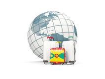 Luggage with flag of grenada. Three bags in front of globe Stock Photo