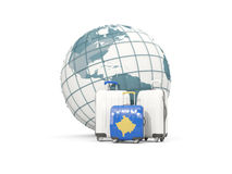 Luggage with flag of kosovo. Three bags in front of globe Royalty Free Stock Images