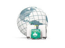 Luggage with flag of macao. Three bags in front of globe Royalty Free Stock Photography