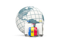 Luggage with flag of moldova. Three bags in front of globe. 3D illustration Royalty Free Stock Photos