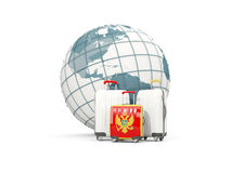 Luggage with flag of montenegro. Three bags in front of globe. 3D illustration Royalty Free Stock Image
