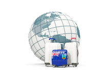 Luggage with flag of montserrat. Three bags in front of globe Royalty Free Stock Image
