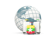 Luggage with flag of myanmar. Three bags in front of globe. 3D illustration Royalty Free Stock Photo