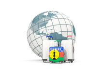 Luggage with flag of new caledonia. Three bags in front of globe. 3D illustration Royalty Free Stock Photography