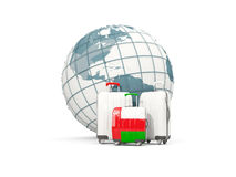 Luggage with flag of oman. Three bags in front of globe. 3D illustration Royalty Free Stock Images