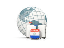Luggage with flag of paraguay. Three bags in front of globe. 3D illustration Royalty Free Stock Images