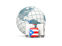 Luggage with flag of puerto rico. Three bags in front of globe. 3D illustration Royalty Free Stock Photo