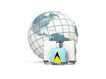 Luggage with flag of saint lucia. Three bags in front of globe. 3D illustration Stock Image